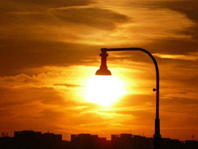 Outdoor Lamp (with no bulb), setting sun in background